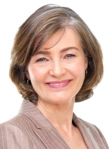 Portrait of a businesswoman smiling against white background